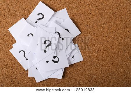Closeup shot of a lot of paper with Question mark. stock photo