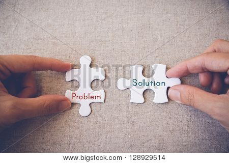puzzle jigsaw business concept problem solution words pieces background solution hands white global idea connection together match part work people challenge cooperation fit join two pattern shape complete object solve symbol teamwork vintagecopy space