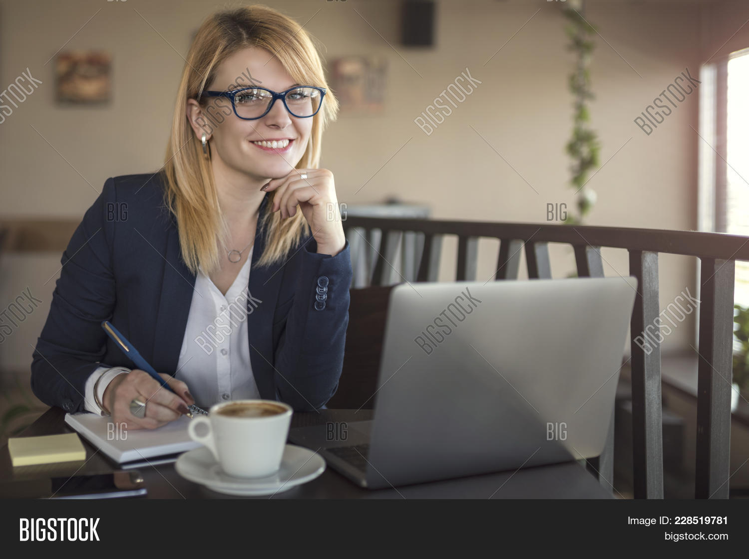 Business Woman Is Working On Computer, In A Coffee Shop, Restaurant. Charming Happy Woman Student Us