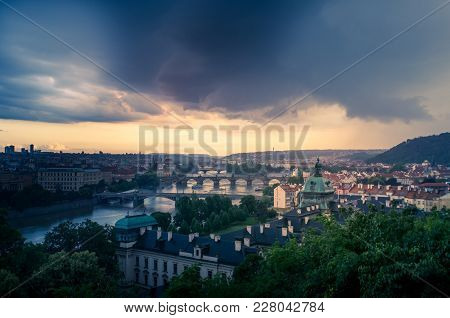 An ominous storm bears down on the city of Prague at sunset, as seen from the viewpoint at Letna Park. stock photo