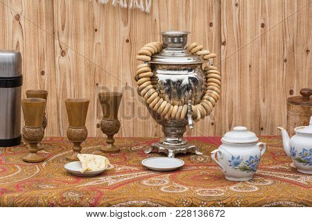 The concept of tea drinking. Samovar, bagels and tea set stock photo