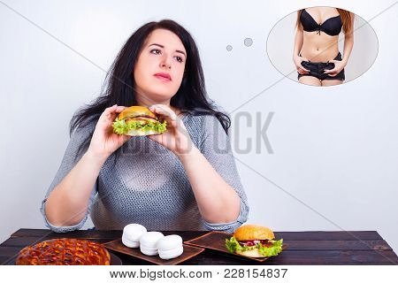 Overweight is a heavy luggage. Obese fat young woman with a great backpack full of junk food on her belly as a symbol of excess weight. Dieting, weight losing, motivation concept stock photo