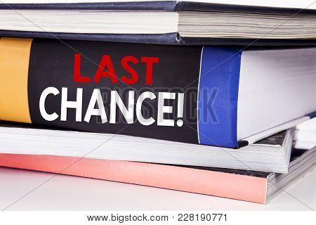 Hand writing text caption inspiration showing Last Chance. Business concept for Deadline Time Ending  written on the book the white background. stock photo