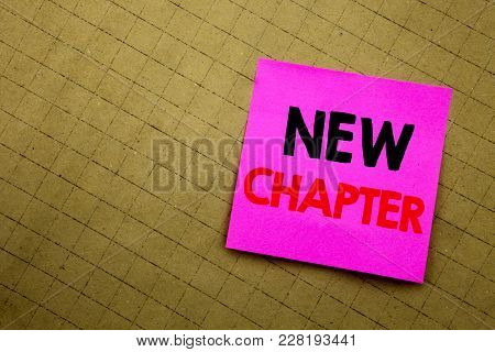 Handwritten text caption showing New Chapter. Business concept writing for Starting New Future Life written on sticky note paper on yellow background. stock photo