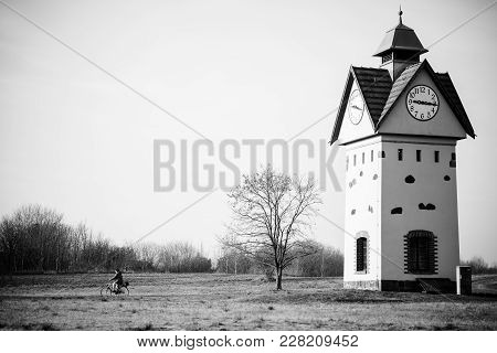 Clock Tower in one of the oldest villages in Germany - Gielsdorf (Altlandsberg). The first mention in the chronicles of 1375. Federal state of Brandenburg. Black and white. stock photo