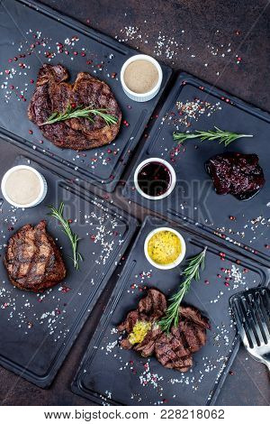 Four steaks cooked on a grill shot from the top close up stock photo