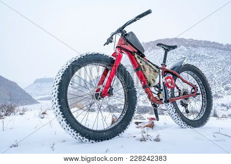 A fat bike in a snow blizzard at Colorado foothills - Lory State Park stock photo