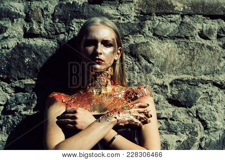 Zombie, scary undead zombie girl. Girl on stone background. Young woman in day of dead, face art. Halloween face art stock photo