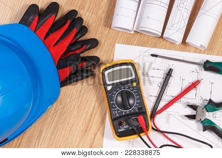 Electrical construction drawings or diagrams, multimeter for measurement in electrical installation and accessories for use in engineer jobs stock photo