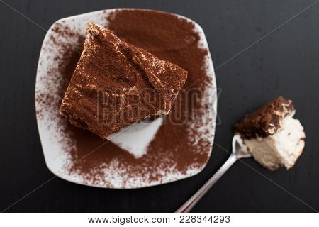 Home made chocolate meringue brownies on a table stock photo