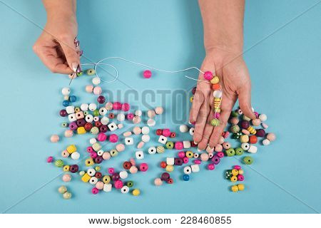 Creating a string of perls with a needle stock photo