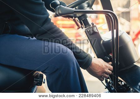 Closeup Man drives a reliable heavy truck loader. Heavy duty equipment. Tractor or roller paving vehicle stock photo