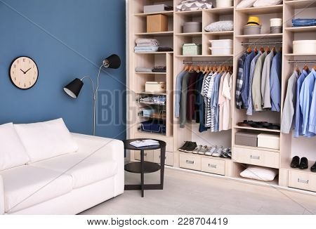 Dressing room interior with big wardrobe stock photo