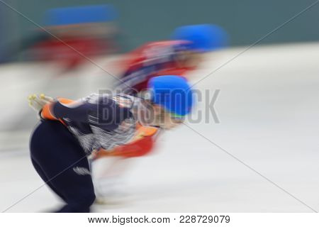Motion blurred image of short track speed skating competitions stock photo