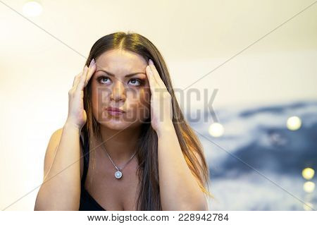 A lonely young woman, she is depressed and separated from problems in her personal life. The concept of loneliness and loss of love. stock photo
