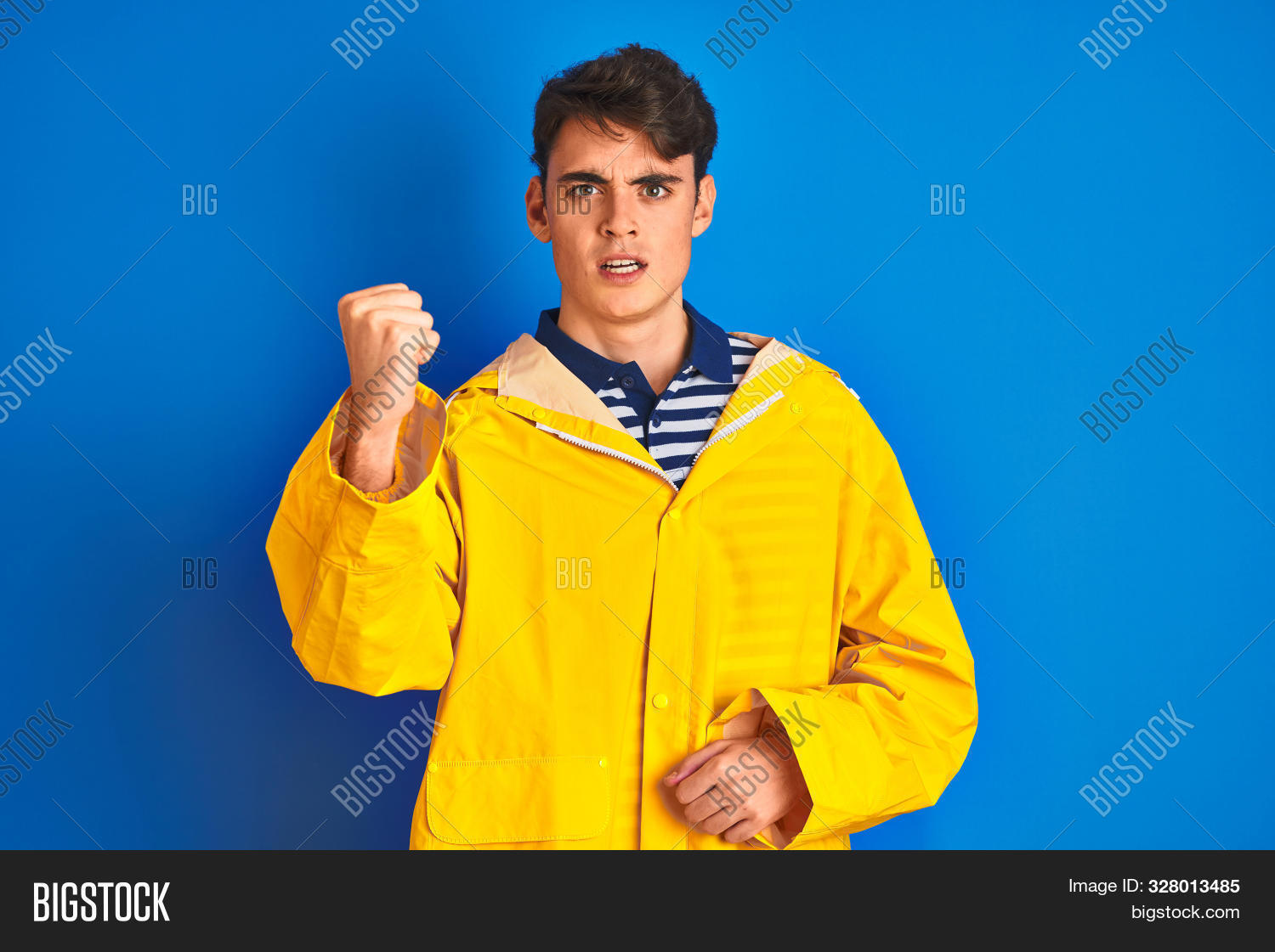 activity,aggressive,anger,angry,background,bad,boy,caucasian,clothes,crazy,emotion,enraged,expression,face,fight,fish,fisher,fisherman,fist,fists,frustrated,frustration,fun,furious,hand,hands,handsome,hat,isolated,mad,man,people,person,portrait,punching,rage,red,scream,serious,shouting,sport,stress,strong,teen,teenager,teeth,unhappy,upset,yellow,young