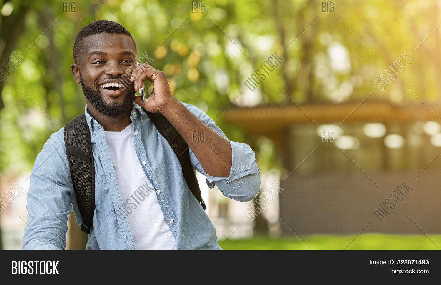 adult,attractive,background,backpack,bag,black,business,businessman,call,casual,cellphone,city,concept,connection,conversation,gadget,guy,handsome,laughing,lifestyle,looking,male,man,millennial,outdoor,panorama,people,person,phone,pleasant,portrait,smartphone,smile,smiling,successful,summer,talking,technology,telephone,tourist,travel,traveller,urban,walking,wireless,young
