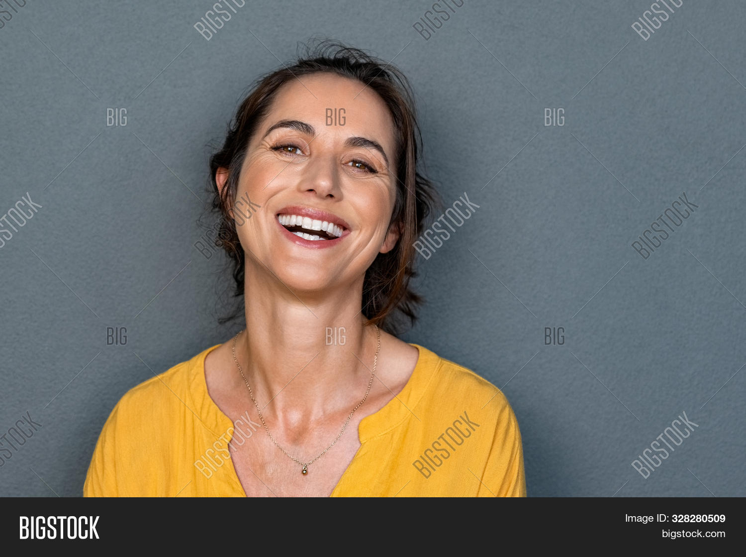attractive,background,beautiful,beauty,business,carefree,casual,cheerful,close up,confident,copy space,dental,energy,entrepreneur,expression,face,fresh,fun,gray,gray background,grey,grey wall,happiness,happy,healthy,healthy lifestyle,hispanic,isolated,joy,joyful,latin,laugh,laughing woman,looking,looking at camera,mature,mid adult woman,middle aged woman,people,portrait,positive,satisfaction,smile,success,successful,teeth,wall,white,woman