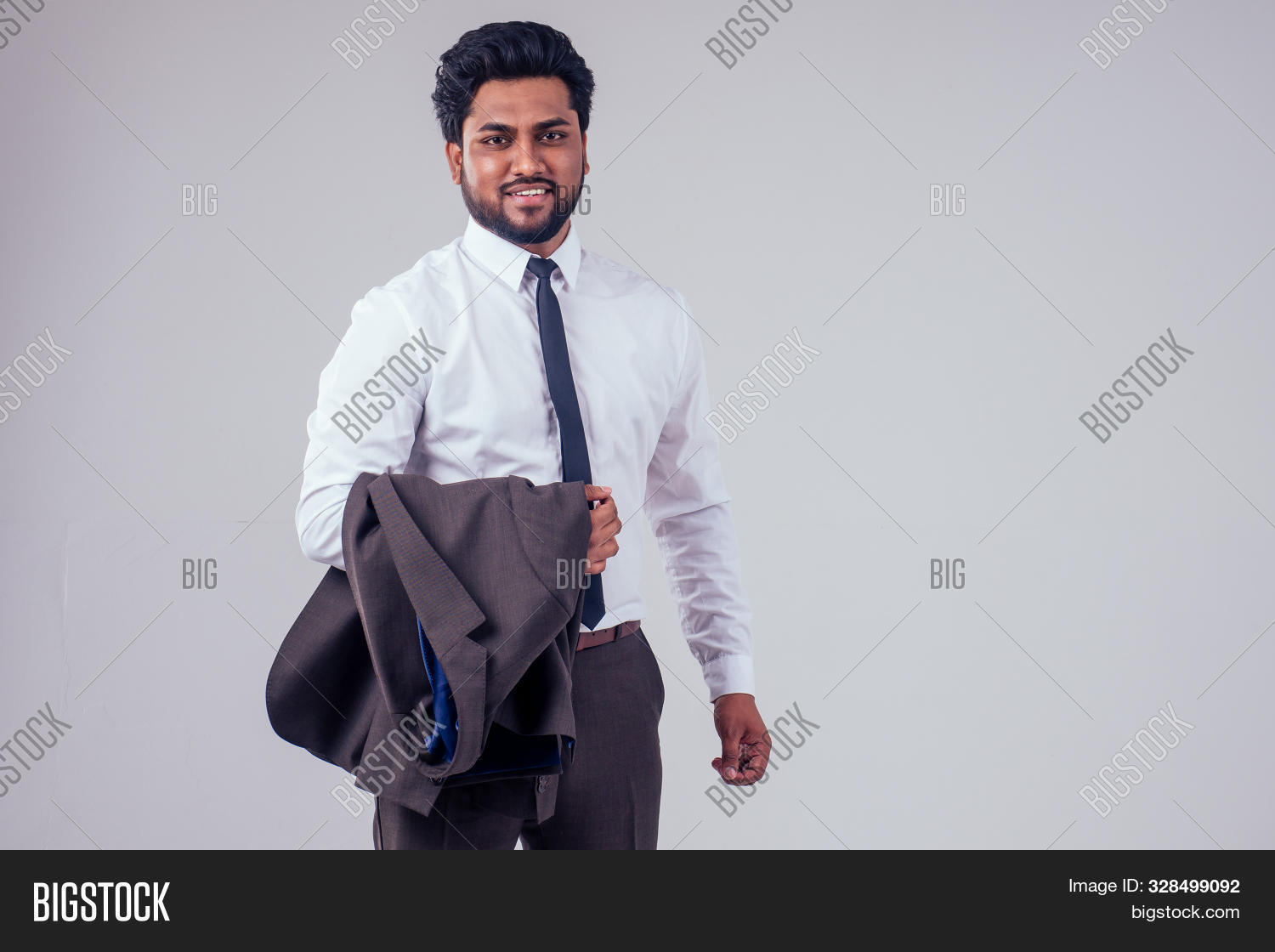 adult,arab,asian,attractive,beard,boss,business,camera,career,celebration,ceo,clothes,confident,corporate,eastern,employee,entrepreneur,excited,executive,fashion,happy,indian,jacket,job,leader,leadership,looking,male,man,manager,modern,office,outfit,people,person,portrait,professional,proud,shirt,smile,stylish,success,successful,suit,tie,triumph,victory,work,worker,young