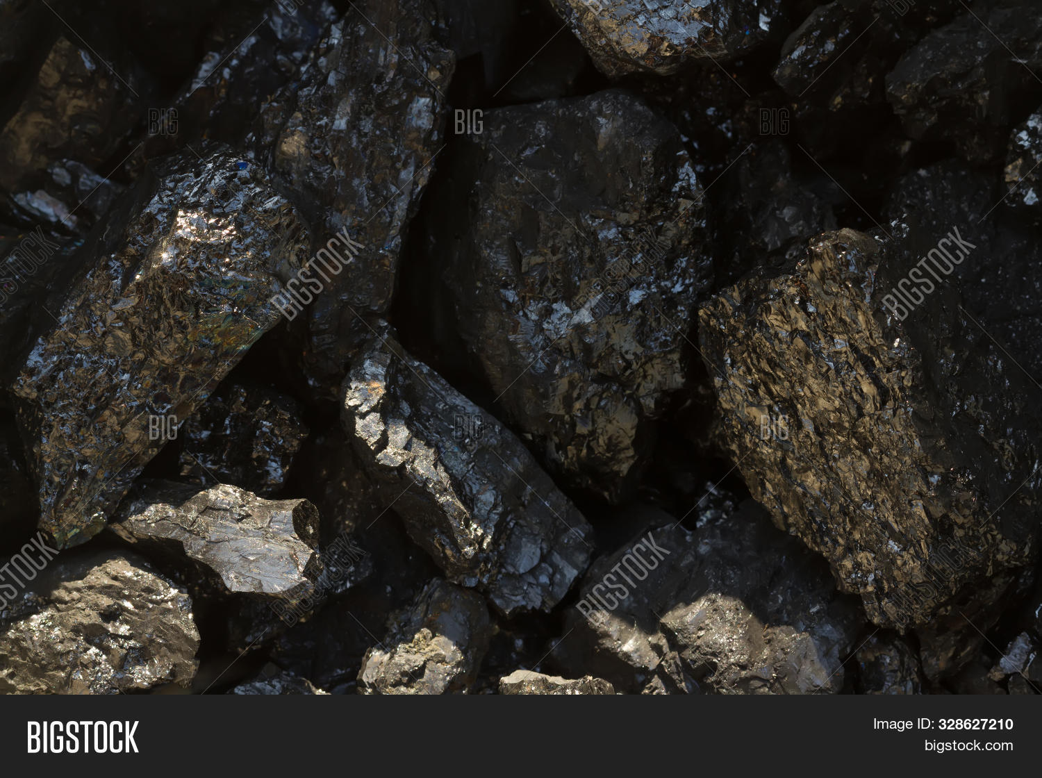 Black coal mine close-up with soft focus. Anthracite coal bar on dark background. Natural black coal bars for background. Industrial coal nuggets close up