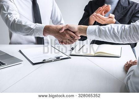 Successful job interview, Image of Boss employer committee or recruiter in suit and new employee shaking hands and clap after good deal negotiation interviewing, career and placement concept. stock photo