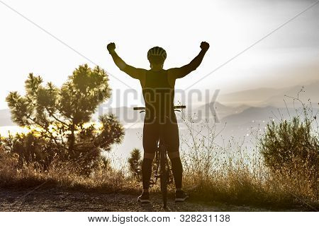 Success, achievement, accomplishment and winning concept with male mountain biker stock photo