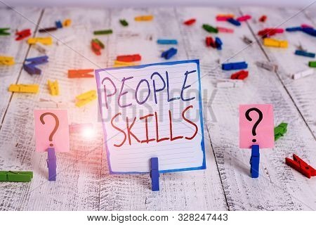 Conceptual hand writing showing People Skills. Business photo showcasing Get Along well Effective Communication Rapport Approachable Crumbling sheet with paper clips placed on the wooden table. stock photo