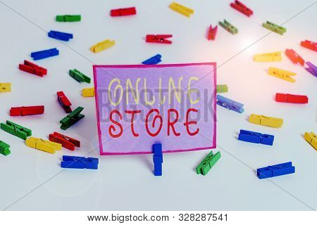 Conceptual hand writing showing Online Store. Business photo text A website that offers items for sale and accept credit cards Colored clothespin papers empty reminder white floor office. stock photo