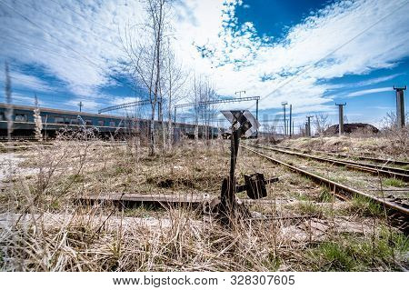 Abandoned railway station . Rusty weathered peeled paint of an old wagon. Blue railway carriage. stock photo