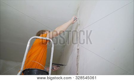 Plasterer putting plaster on wall. Worker covers the wall with mortar. stock photo