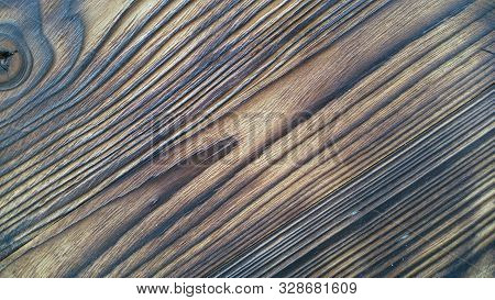 Wood texture used as natural background. Wood with a natural pattern. Brown wood texture. Abstract background stock photo