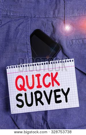 Handwriting text Quick Survey. Concept meaning Conduct fast check on condition value situation of something Smartphone device inside formal work trousers front pocket near note paper. stock photo