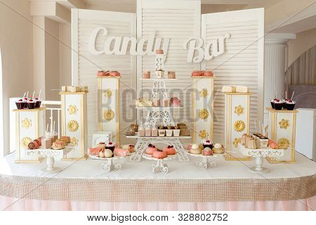 Candy Bar. Delicious sweet buffet with cupcakes. Sweet holiday buffet with cupcakes and other desserts. stock photo