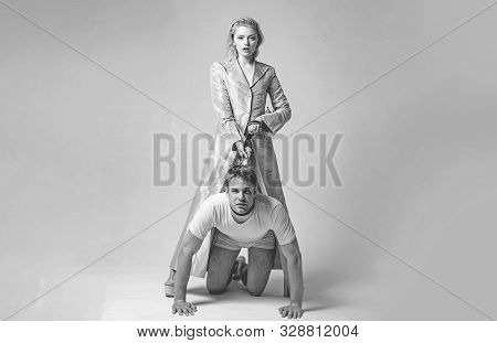 Dominantning in the foreplay sexual game. Woman and man playing domination games. Love relations and dominating. Concept of sexual domination or bondage. Dominant womans. stock photo