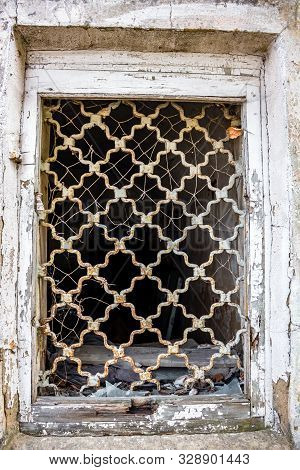 Forged window grille of an old abandoned house. Borovsk, Russia stock photo