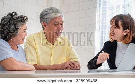 Senior couple get advice from financial planner at home.aging at home stock photo