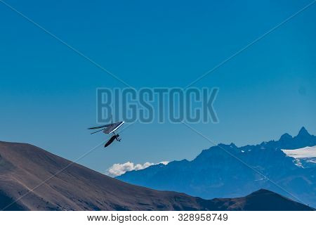 Hang-gliding in Swiss Alps from top of Rochers-de-Naye, near Montreux, Canton of Vaud, Switzerland. stock photo