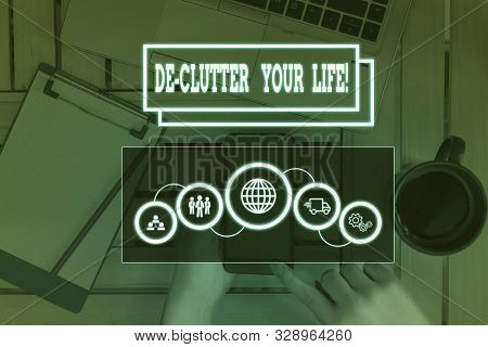 Conceptual hand writing showing De Clutter Your Life. Business photo showcasing remove unnecessary items from untidy or overcrowded places Picture photo network scheme with modern smart device. stock photo