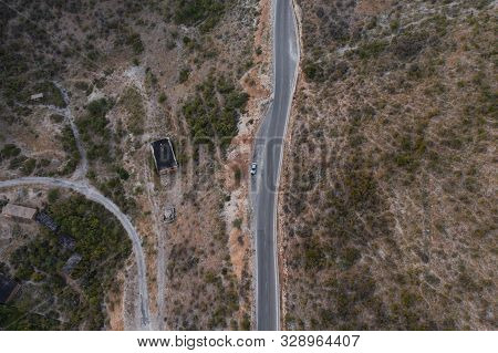 Aerial above view of a rural landscape with a straight road. Drone photography. Amazing nature landscape. Aerial view from flying drone. Horizontal photo. stock photo
