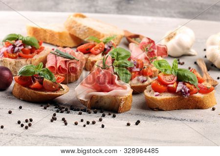 Assorted bruschetta with various toppings. Appetizing bruschetta or crudo crostini. Variety of small sandwiches. Mix bruschetta stock photo