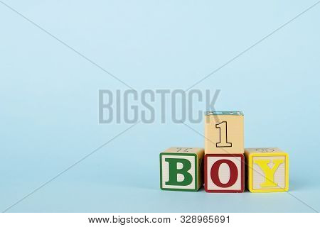 Blue background with colored cubes with letters Boy and number, baby development and toys for toddlers stock photo