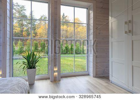 Bright photo studio interior with big window, high ceiling, white wooden floor stock photo