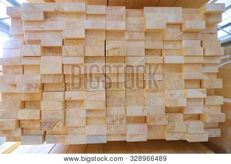 Stack of two-layer wooden glued laminated timber beams from pine finger joint spliced boards for wooden windows stock photo