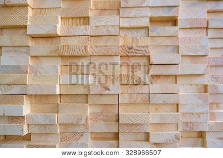 Stack of three-layer wooden glued laminated timber beams from pine finger joint spliced boards stock photo