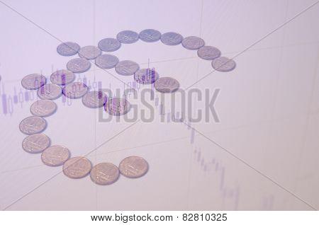 Euro sign & falling eurusd chart as background. stock photo
