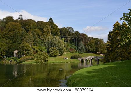 National Trust property Stourhead House and Gardens in Wiltshire. Palladian Manor house and landscaped gardens and lake. stock photo