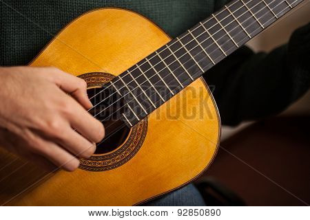 Detail of a man playing a guitar stock photo