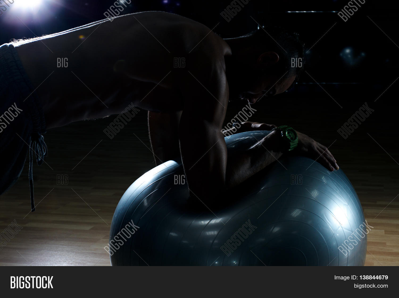 Athlete doing Push-ups in gym. Beautiful body. Bodybilding