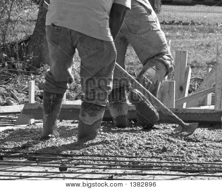construction crew working on a concrete house slab stock photo