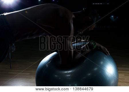 Athlete doing Push-ups in gym. Beautiful body. Bodybilding stock photo